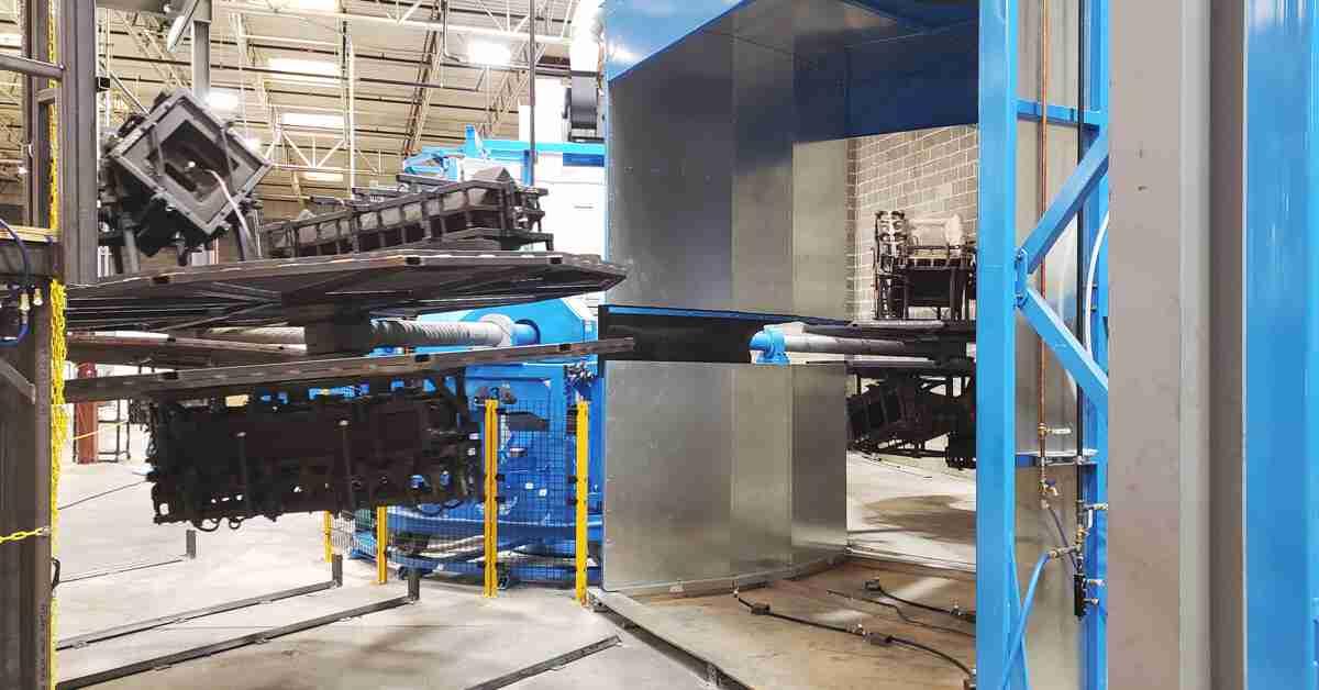 Multiple molds on rotational molding machine.